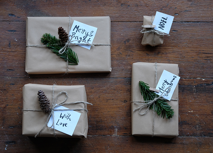 Brown paper wrapped parcel with brown twine and foliage