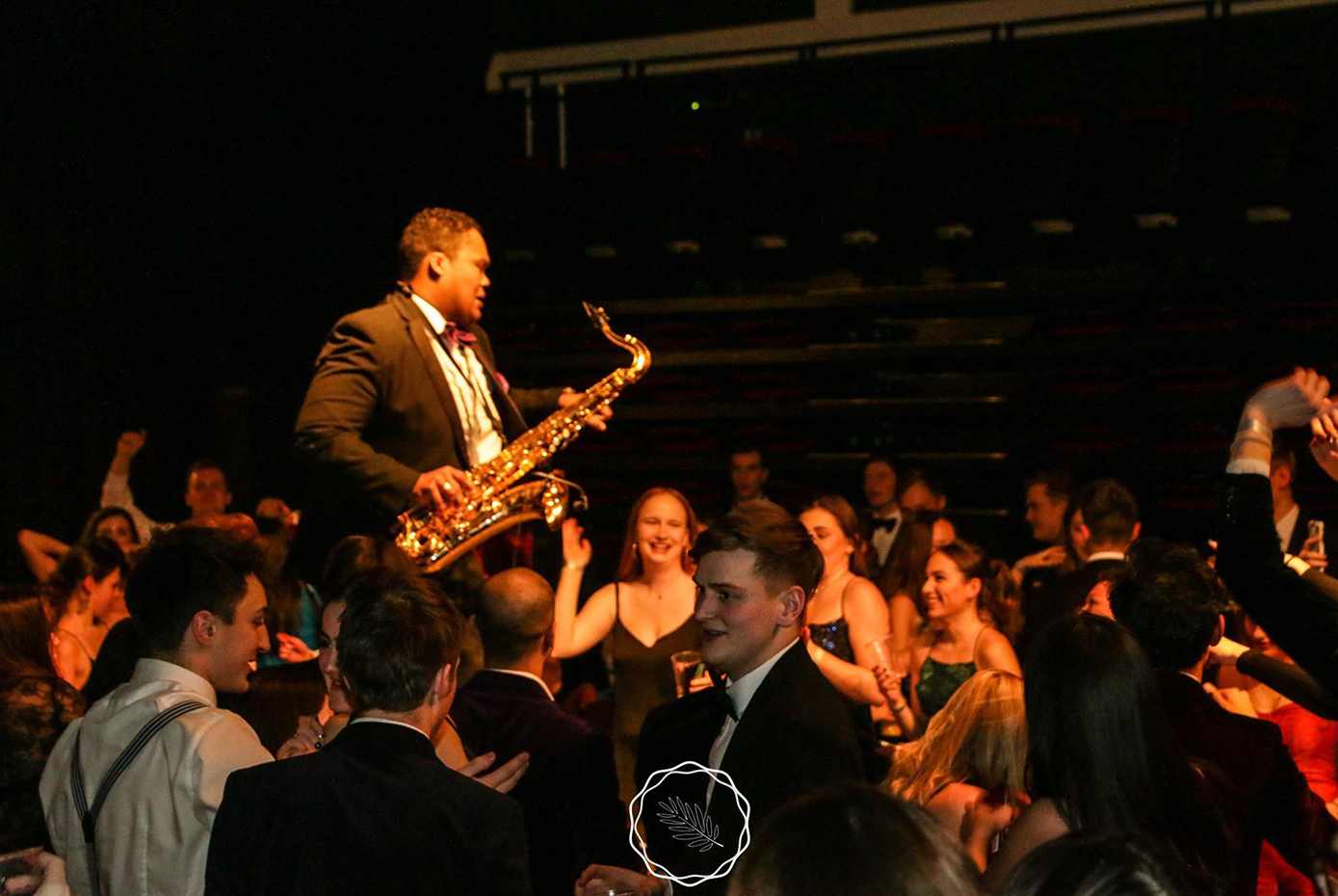 Saxaphone player in tuxedo on catwalk