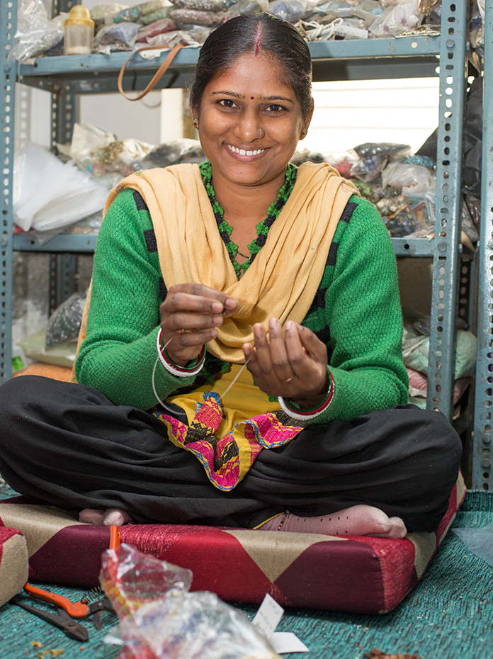 Young Indian lady making handmade jewellery