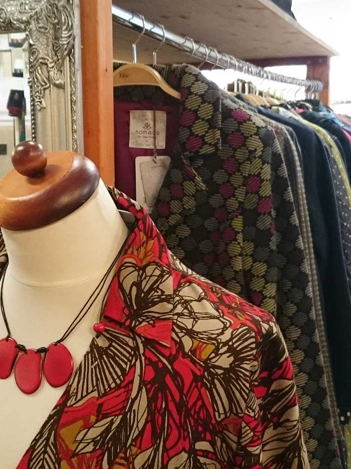 Red floral sustainable dress in fair trade shop