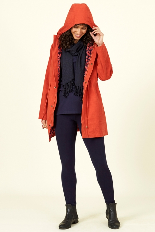 Saffron Red Sustainable Waterproof Coat made with organic cotton and sustainable fibres