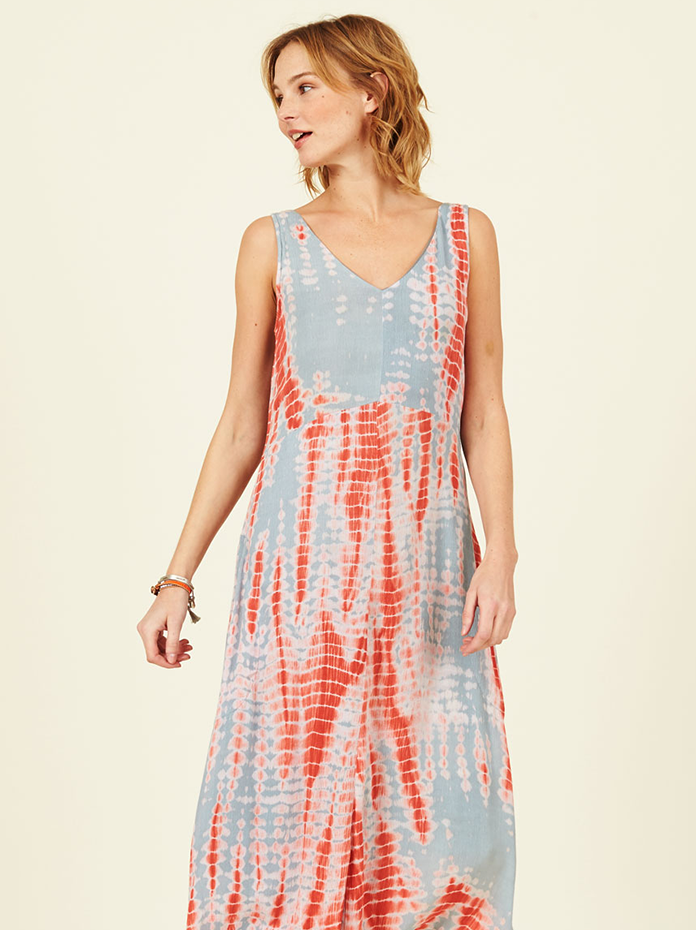 Fair trade tie dye dress in coral with handkerchief hem